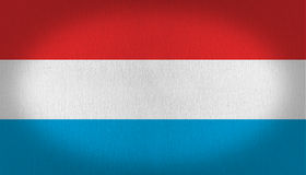 Luxembourg flag. Triple color luxembourg flag with blue white and red stripes, fabric texture flag vignette, texture background Royalty Free Stock Image