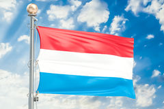 Luxembourg flag waving in blue cloudy sky, 3D rendering Stock Photos