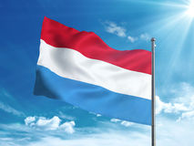Luxembourg flag waving in the blue sky Royalty Free Stock Photography
