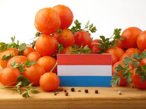 Luxembourg flag on a wooden panel with tomatoes isolated on a wh. Ite background Royalty Free Stock Photos
