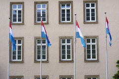 Luxembourg flags and building Royalty Free Stock Image