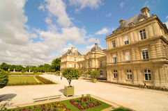 Luxembourg Garden (Jardin du Luxembourg) in Paris, France. Paris, France - July 7, 2015: Tourists admire the panorama of the beautiful Gardens of Luxembourg in stock images