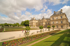 Luxembourg Garden(Jardin du Luxembourg) in Paris, France. Paris, France - July 7, 2015: Tourists admire the panorama of the beautiful Gardens of Luxembourg in royalty free stock photo