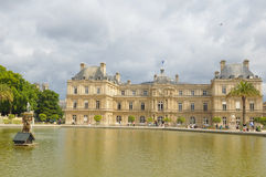 Luxembourg Garden(Jardin du Luxembourg) in Paris, France. Paris, France - July 7, 2015: Tourists admire the panorama of the beautiful Gardens of Luxembourg in stock photos