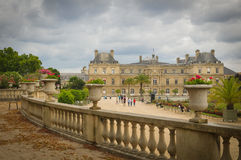 Luxembourg Garden (Jardin du Luxembourg) in Paris, France. Paris, France - July 7, 2015: Tourists admire the panorama of the beautiful Gardens of Luxembourg in royalty free stock photos