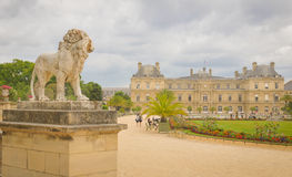 Luxembourg Garden (Jardin du Luxembourg) in Paris, France. Paris, France - July 7, 2015: Tourists admire the panorama of the beautiful Gardens of Luxembourg in stock image