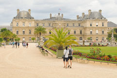 Luxembourg Garden (Jardin du Luxembourg) in Paris, France. Paris, France - July 7, 2015: Tourists admire the panorama of the beautiful Gardens of Luxembourg in royalty free stock photo