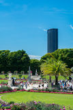 The Luxembourg Garden and the Montparnasse Tower. Paris, France - August 14, 2016: The Luxembourg garden covers 23 hectares and is known for the Luxembourg stock photo