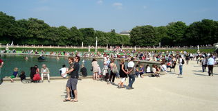 Luxembourg garden paris. Biggest public park in Paris, France. Luxembourg In typical sundays it remains crowded. People use to play games, read, rest and do some stock photo