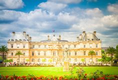 Luxembourg garden, Paris. Luxembourg garden with green lawn at summer day, Paris France, toned stock photo