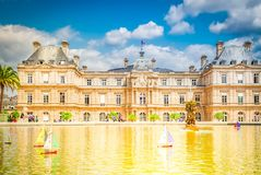 Luxembourg garden with pond. Luxembourg garden and large pond with boats, Paris, France, retro toned royalty free stock photo