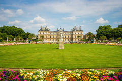 Luxembourg gardens and palace with puffy clouds in Paris Stock Photo