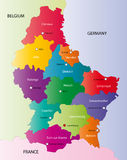 Luxembourg map. Designed in illustration with the regions colored in bright colors and with the main cities. On an illustration neighbouring countries are shown Stock Photos