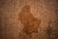 Luxembourg map on vintage paper background. Luxembourg map on a old vintage crack paper background Royalty Free Stock Photography
