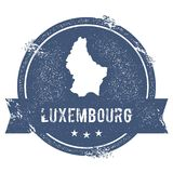 Luxembourg mark. Travel rubber stamp with the name and map of Luxembourg, vector illustration. Can be used as insignia, logotype, label, sticker or badge of Stock Photos