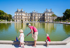 Luxembourg Palace. Paris, children playing with model boats.n royalty free stock images