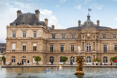 Luxembourg Palace and pond with the fountain Stock Photography