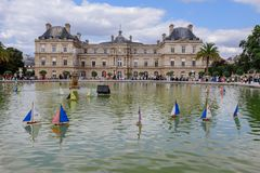 Luxembourg Palace with Wooden Boats in Pool royalty free stock images