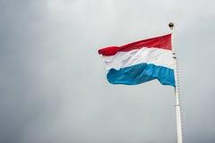 Luxembourg sjunker att fladdra i vinden Arkivbilder