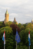 Luxembourg. View of Luxembourg city with Luxembourg and European Union flags in front and Spuerkees (State savings Bank headquarters stock photo