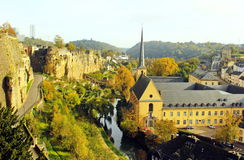 Luxembourg view of Grund and Abbey de Neumunster. View of Luxembourg lower part called Grund and of the monastery in a beautiful sunny day of autumn stock photo