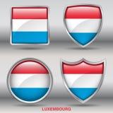 Luxemburgo embandeira na coleção de 4 formas com trajeto de grampeamento Foto de Stock Royalty Free