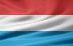 Luxemburgo señala por medio de una bandera Foto de archivo libre de regalías