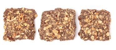 Chocolate Covered English Toffee Coated in Nuts on a White Backg. Luxery Chocolate Covered English Toffee Coated in Nuts on a White Background Stock Image