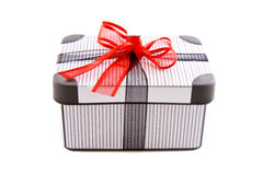 Luxery gift box. Luxery striped gift box with a red knot isolated over white Stock Photos