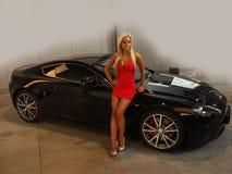 Luxo modelo do transporte da feira automóvel da Menina-forma Fotos de Stock