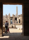 Luxor. Tourists looking at a pillar and the ruins at Luxor Royalty Free Stock Images