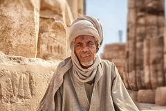 A Beduin man in the Temple city of Luxor in in the Egypt, Luxor city. Luxor, Egypt - Feb 19 2019: a Beduin man in the Temple city of Luxor in in the Egypt, Luxor royalty free stock image