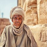 A Beduin man in the Temple city of Luxor in in the Egypt, Luxor city. Luxor, Egypt - Feb 19 2019: a Beduin man in the Temple city of Luxor in in the Egypt, Luxor royalty free stock images