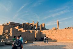 Luxor, Egypt. February 20, 2017: View f the backside of the ruins of Luxor temple at sunset. Luxor, Egypt. February 20, 2017: View of the backside of the ruins Stock Photography