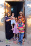 LUXOR, EGYPT - NOVEMBER 6, 2011: An Egyptian family posing at the entrance of her house in the village of Gabawi royalty free stock image