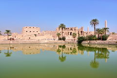 LUXOR, EGYPT: Reflections on the Sacred Lake at Karnak temple Royalty Free Stock Photos