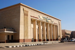 Luxor Railway Station, Egypt. The impressive facade of Luxor Railway station in Egypt with police security and a taxi outside Stock Images