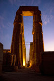 Luxor Temple. A corridor of columns inside Luxor Temple at sunset, Egypt Stock Image