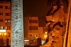 Luxor Temple at night. Giant statues of Ramses  II enthroned and the great obelisk in front of the ancient egyptian temple of Luxor in the town centre. Egypt Royalty Free Stock Photo