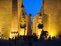Luxor temple at night. Colossus and obelisk at entrance of Luxor temple, Thebes. Egypt series (unrecognizable people Royalty Free Stock Photo