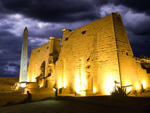Luxor temple at night. Colossus and obelisk at entrance of Luxor temple, Thebes. Egypt series Royalty Free Stock Photo