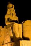 Luxor Temple by night. Egypt. Illuminated Luxor Temple. Granite statue of Ramesses II Stock Photos