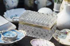 Luxory chest and porelain plates on table Stock Photos