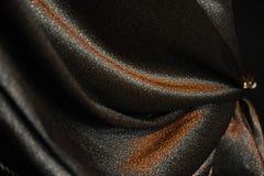 Luxuoso drapeje Close-up Textura da tela brilhante foto de stock