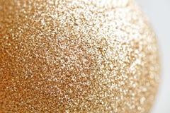Luxuriöse Beschaffenheit des goldenen Funkelns Glänzender Hintergrund der Partei für Feierkonzept Stockbild
