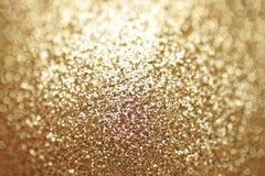 Luxuriöse Beschaffenheit des goldenen Funkelns Glänzender Hintergrund der Partei für Feierkonzept Lizenzfreie Stockfotos