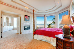 Luxuriant master bedroom with fireplace Stock Photos