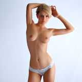 Luxuriant nude woman in topless and blonde hair posing Royalty Free Stock Photos