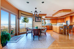 Luxuriant round kitchen room and dining area with walkout deck Stock Images
