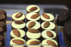 Luxurious almond Chocolates at a store display Stock Photos
